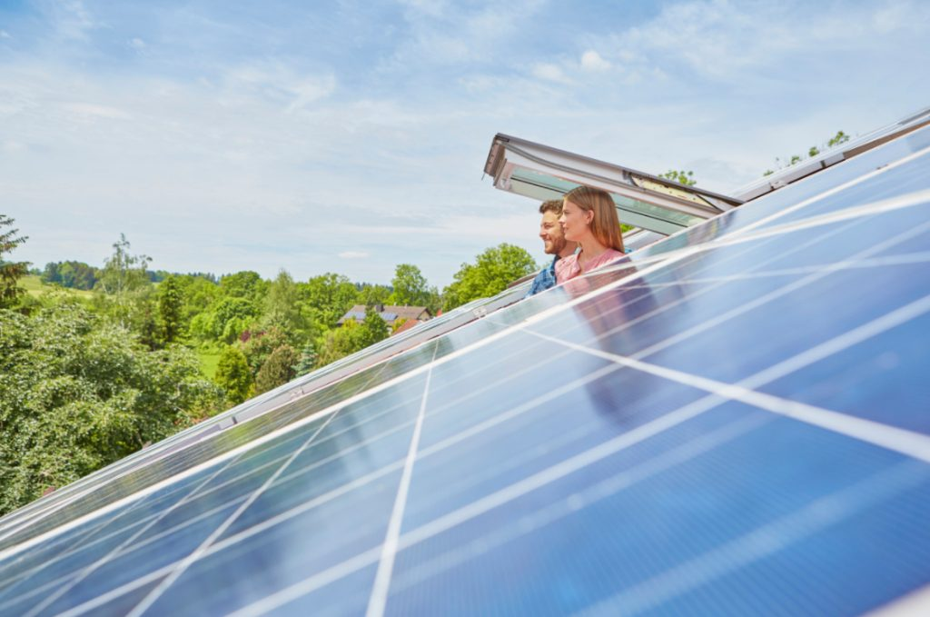 couple save money with solar panels