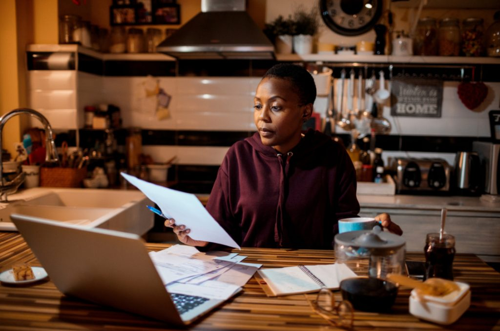 Woman calculating expenses and tracking savings